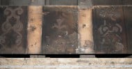 The painted underside of a floorboard that formed part of an ornate late 16th century painted ceiling recently recorded in the North Block of Riddles Court.