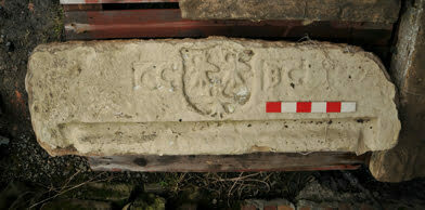Marriage stone with carved initials